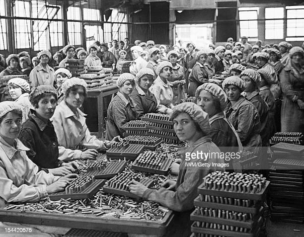Women At Work During The First World War, Women munition workers finish small arms cartridges in Small Arms Cartridge Factory No.3 at Woolwich...