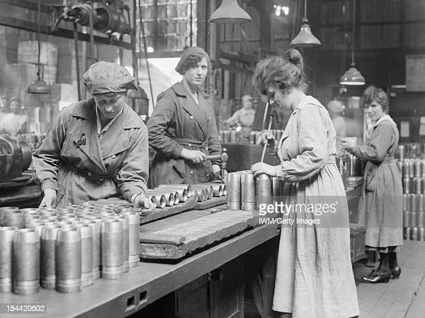 Women At Work During The First World War Women war workers gauge the thickness of the heads of shells at Royal Shell Factory 3 Woolwich Arsenal May...