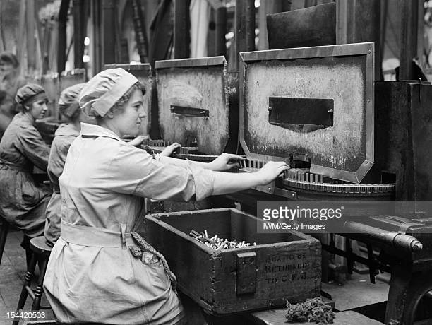 Women At Work During The First World War Women war workers operate annealing machines in Cartridge Factory 5 at the Royal Arsenal Woolwich London May...