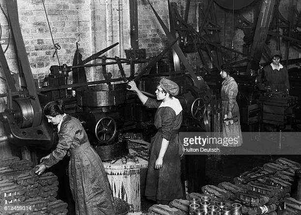 Women at work in a factory making tanks probably during the First World War