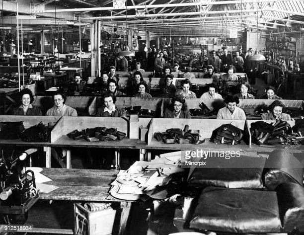 Women at work in a factory sewing leather products Speke Liverpool 8th January 1946