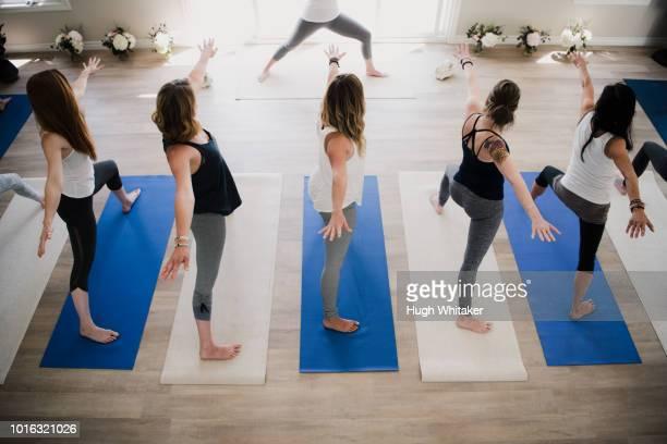women at yoga retreat - yogi stock photos and pictures