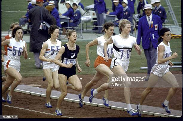 Women athletes in action during the 800 meter run at Summer Olympics