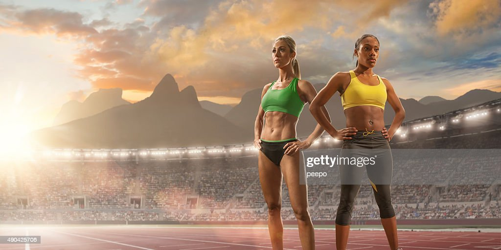 Women Athletes Standing in Olympic Stadium in Rio : Stock Photo