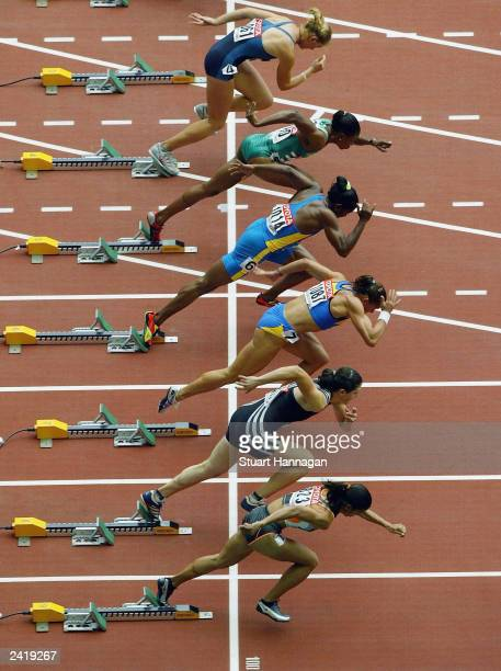 Women athletes takes off from the starting blocks during the first round of the women's 100m heats at the 9th IAAF World Athletics Championship...