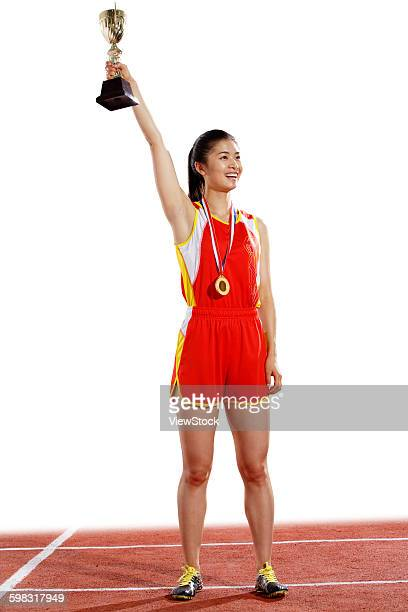 women athletes win medals and trophies - medalist stock photos and pictures