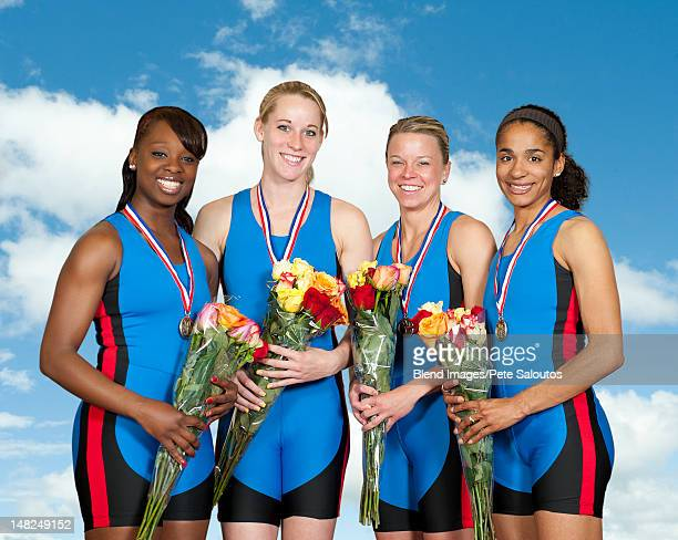 women athletes with medals holding flower bouquets - awards ceremony stock pictures, royalty-free photos & images
