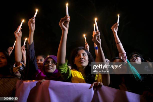Women attend a candlelight vigil in the early hours of March 8 2020 in Dhaka Bangladesh International Women's Day is observed on March 8 every year...