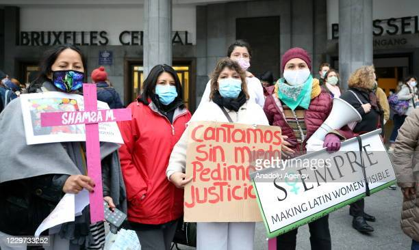Women attend a demonstration called by the Mirabal Belgium association, against the violence against women, on November 22, 2020 in at the Central...