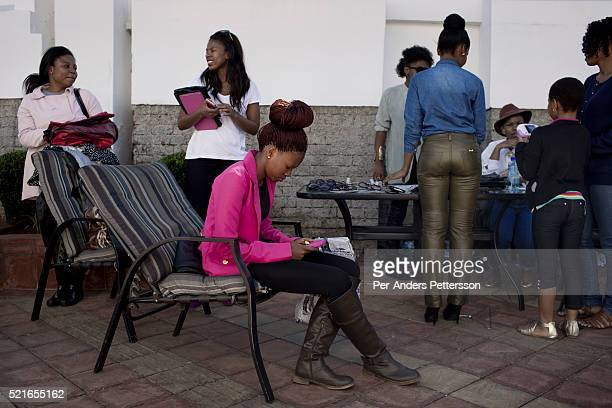 Women attend a market selling famous brand clothes on April 27 2013 in Soweto South Africa The monthly market attracts newly wealthy women from...