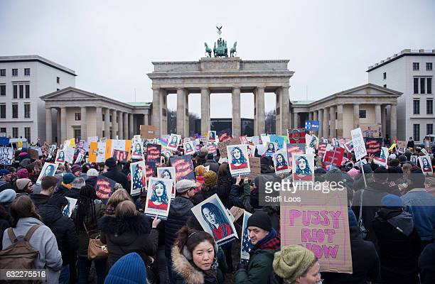 Women attend a protest for women's rights and freedom in solidarity with the Women's March on Washington in front of Brandenburger Tor on January 21...