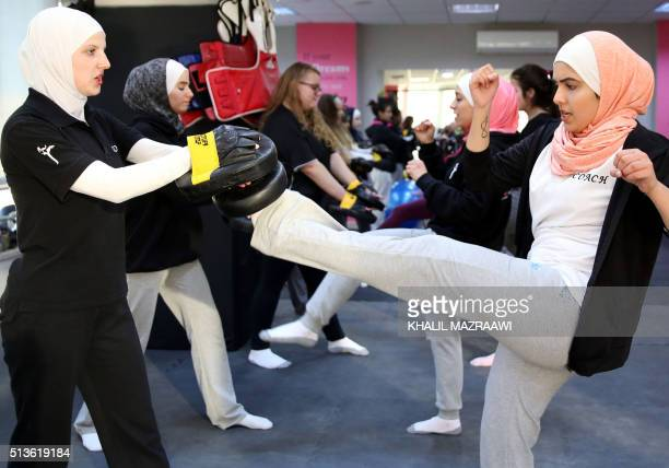 Women attend a selfdefence class on February 15 2016 in the Jordanian capital Amman Taekwondo black belt Lina Khalifeh started teaching selfdefence...