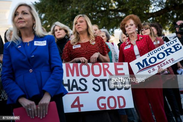 Women attend a 'Women For Moore' rally in support of Republican candidate for US Senate Judge Roy Moore in front of the Alabama State Capitol...