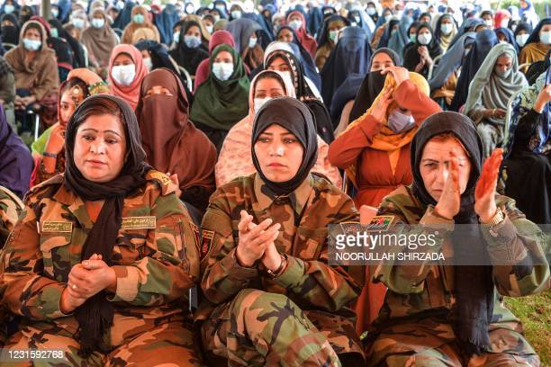 Women attend an event to celebrate International Women's Day in Jalalabad on March 8, 2021.