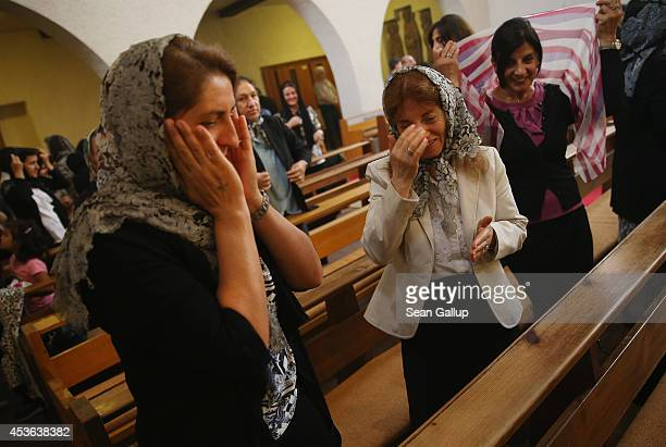 Women attend Mass at the St Jacob Syrian Orthodox Antioch Church on Assumption Day on August 15 2014 in Berlin Germany In Christian tradition...