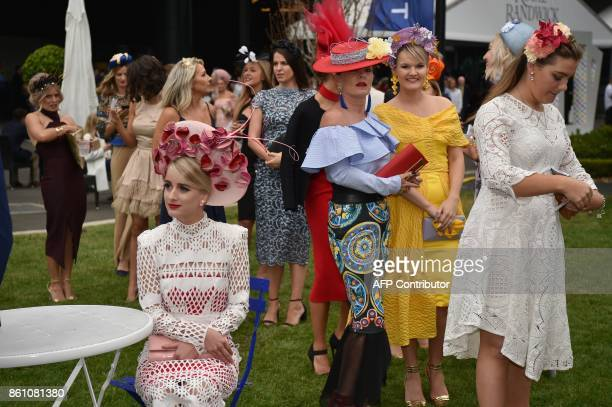 Women attend the Everest 2017 horse race the world richest turf race at Royal Randwick race course in Sydney on October 14 2017 / AFP PHOTO / PETER...