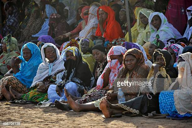 Women attend the funerals of five of the victims of last week's attack in Bamako on November 25 2015 Gunmen went on a shooting rampage at the luxury...