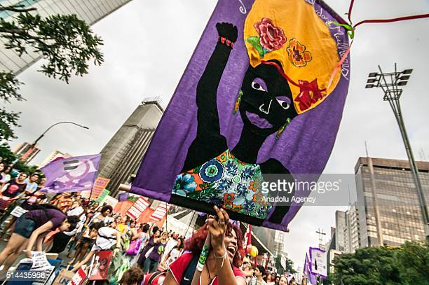 Women attend the International Women's Day celebration as they protest violence against women and chant slogans in favor of abortion in Sao Paulo...