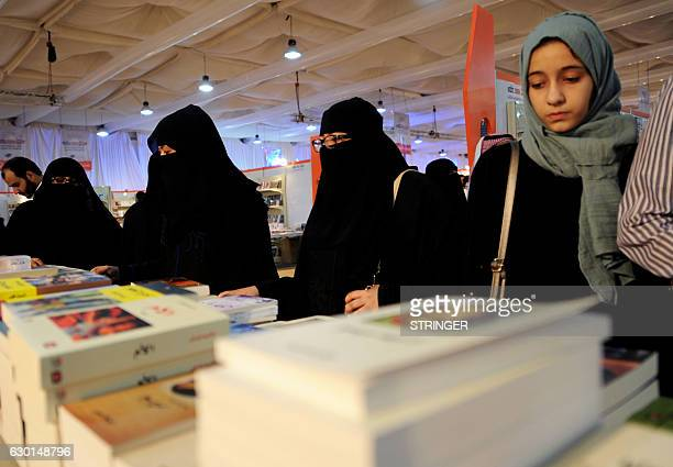 Women attend the Jeddah International Book Fair on December 17 2016 in the Saudi Red Sea port city of Jeddah / AFP / STRINGER