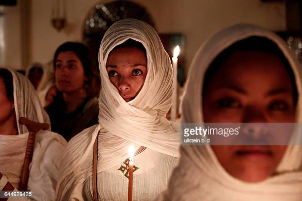 Women attend the mass the night of Holy Saturday at the Ethiopian Church in Athens on April 11 2015