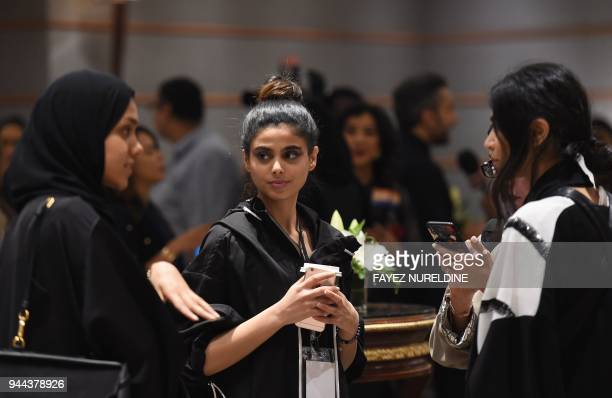 Women attend the opening ceremony of Arab Fashion Week on April 10 at Ritz Carlton hotel in Riyadh