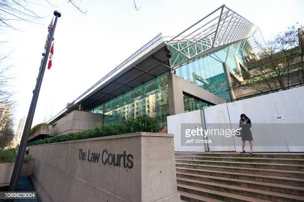 A women attending the bail hearing for Huawei Technologies Chief Financial Officer Meng Wanzhou stands outside during a break in proceedings at BC...