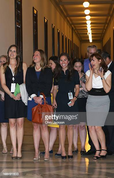 Women await the arrival of HRH Prince Harry before he tours an anti-landmine photography exhibition by The HALO Trust charity during the first day of...