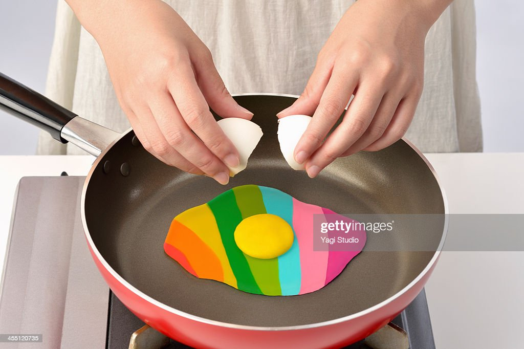 Women bake in a frying pan Colorful Egg : Stock Photo