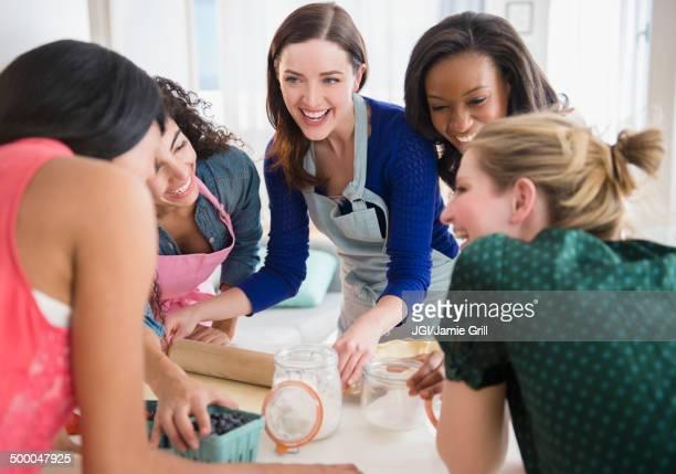 Women baking together in kitchen
