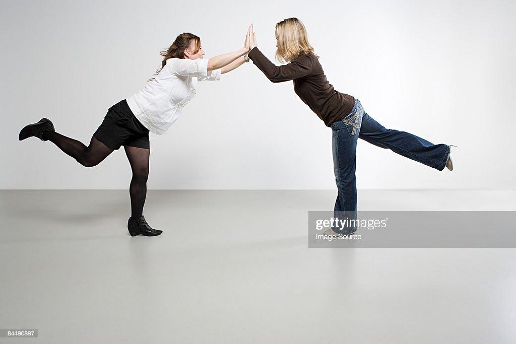 Women balancing : Stock Photo