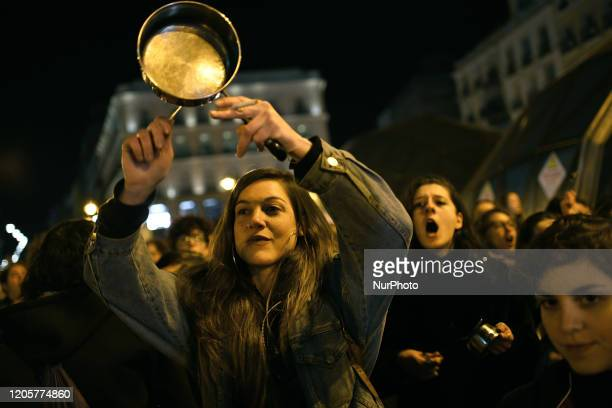 Women bang pots and pans shouting angry slogans during the cacerolada at the Sol square in Madrid on 8th March 2020 International Women's Day