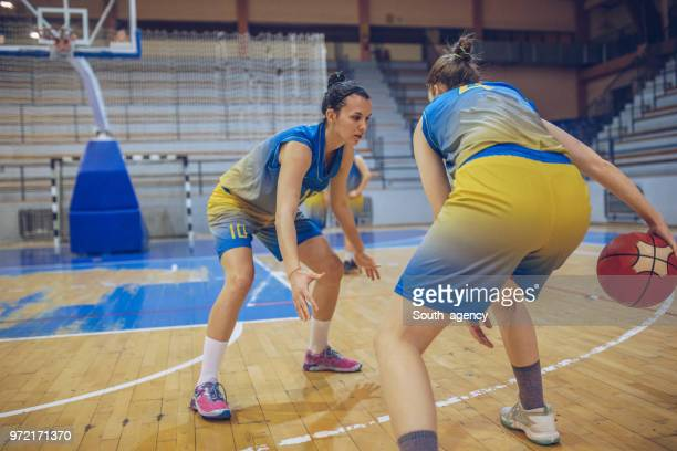 women basketball duel - women's basketball stock pictures, royalty-free photos & images