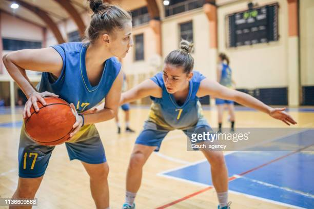 women basketball game - women's basketball stock pictures, royalty-free photos & images