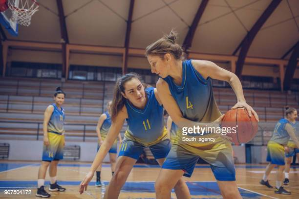 women basketball game - dribbling sports stock pictures, royalty-free photos & images