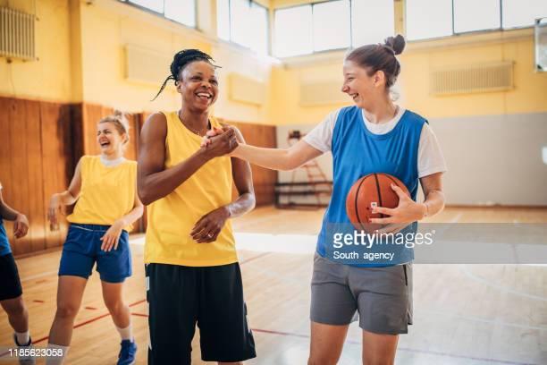 women basketball players handshake after a match - fair play sport foto e immagini stock