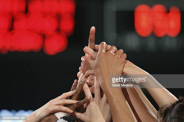 women basketball team celebrating victory, close-up of hands - deporte de equipo fotografías e imágenes de stock