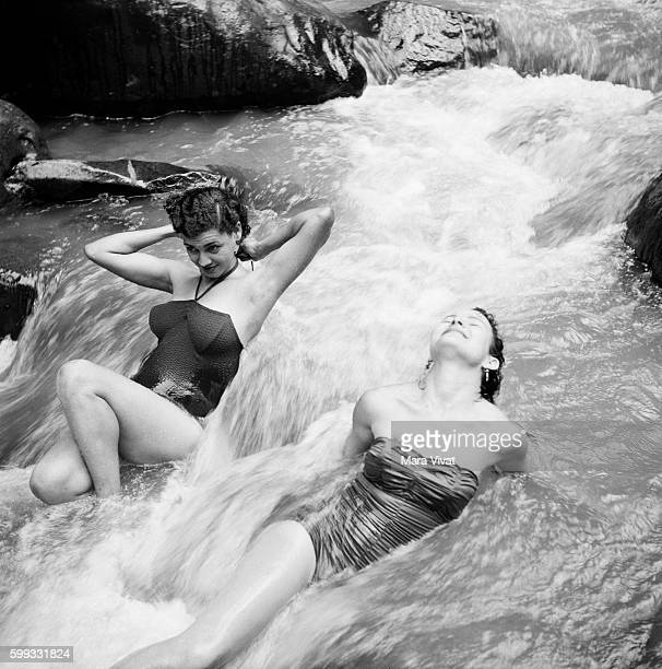 Women Basking in Waterfall
