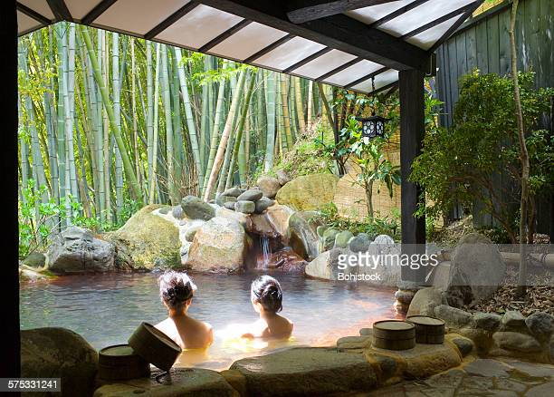 women bathing at hot spring resort - hot spring stock pictures, royalty-free photos & images