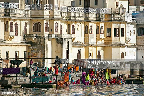 Women bathing in the Ahar River in the city of Udaipur / City of Lakes Rajasthan India