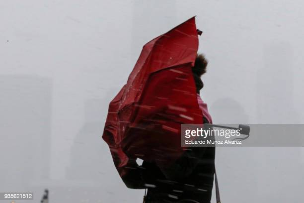 A women battles the heavy wind and snow during a snow storm on March 21 2018 in Jersey City New Jersey At least 12 to 15 inches are expected in parts...