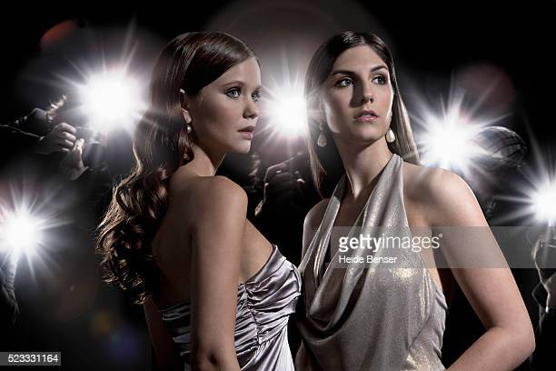 women being photographed by paparazzi - halter neck stock pictures, royalty-free photos & images
