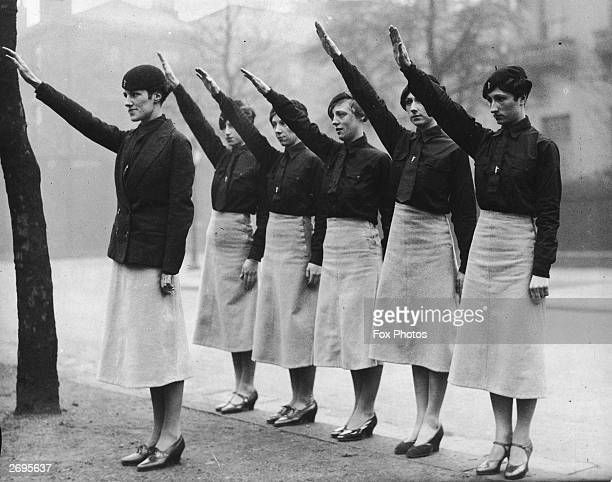 Women 'blackshirts' from Sir Oswald Mosley's British Union of Fascists on parade in Liverpool give the fascist salute Their uniform is a black shirt...