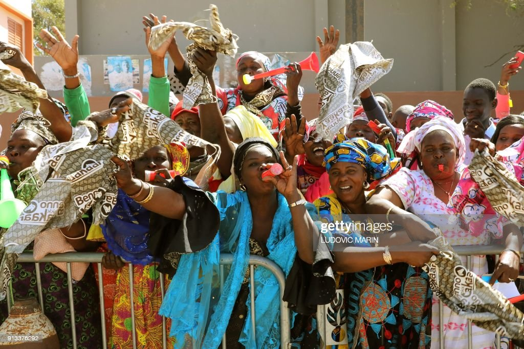 Women blow horns and whistles as they greet the french and women blow horns and whistles as they greet the french and senegalese presidents during the inauguration of the bel air secondary school in dakar on m4hsunfo