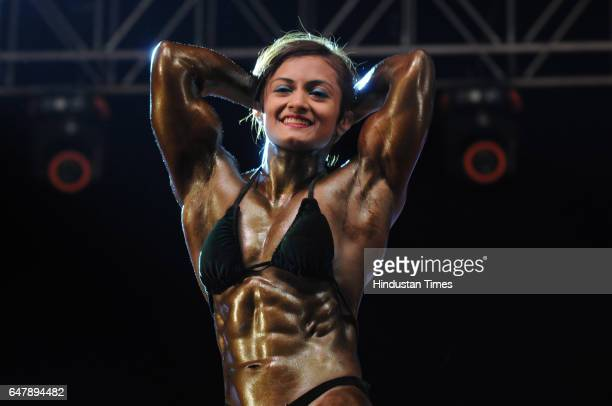 Women body builders Europa Bhoumik from West Bengal showing their physique during the 10th Mr India Mens and Womens bodybuilding national...