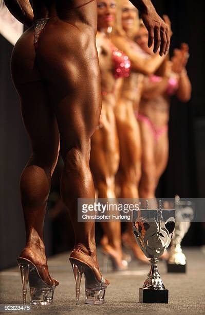 Women bodybuilders pose for judges in The Miss Universe competition at The Southport Theatre on October 24 2009 in Southport England Bodybuilders...