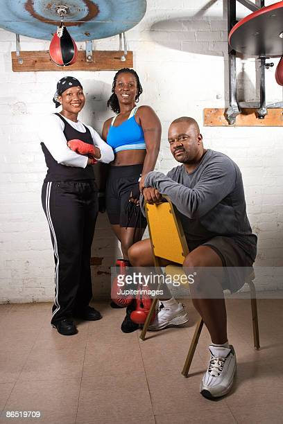 Women boxers and coach in gym