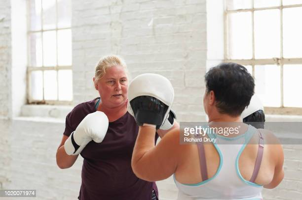 women boxing in the gym - richard drury stock pictures, royalty-free photos & images