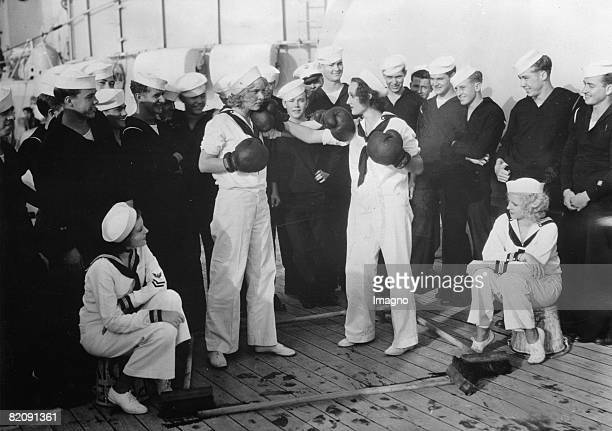 Women boxing on board of a amercian warship for a man that they both love Photograph Around 1930 [FrauenBoxen an Bord eines amerikanischen...