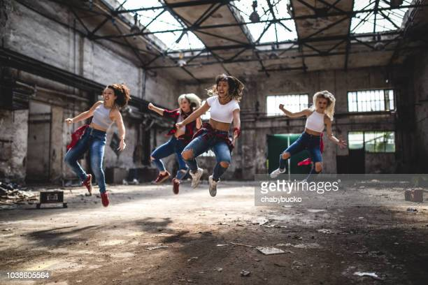 women break-dancers jumping - train band stock photos and pictures