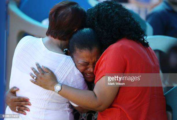 A women breaks down with emotion during a prayer vigil for famlies of Marjory Stoneman Douglas High School where a mass shooting took place at the...